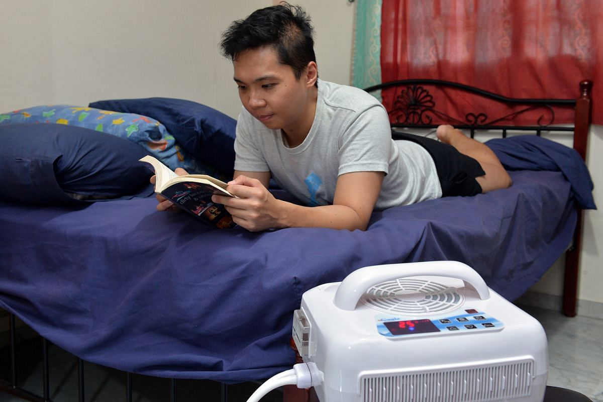 Writer Benson Ang chilling with a temperature-controlled mattress pad.
