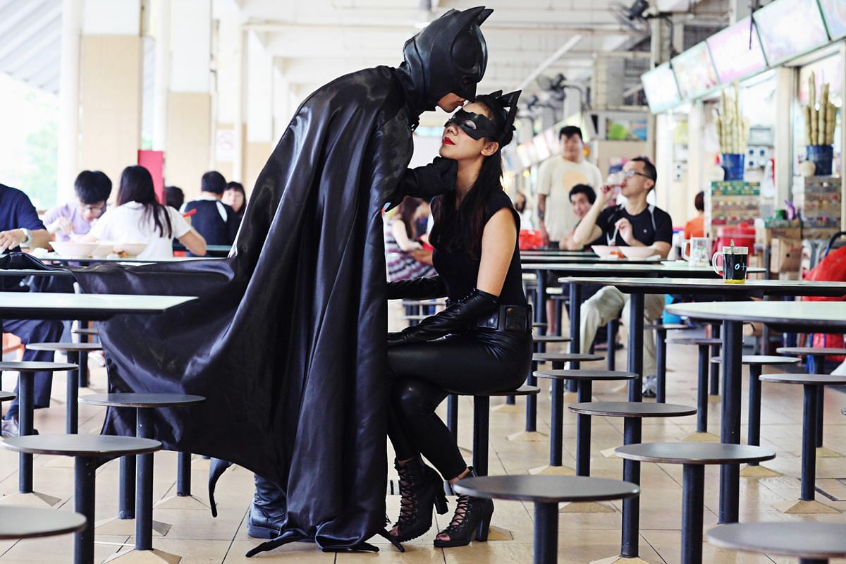Mr Adriel Li and Ms Nicole Andrea Lee (above) took their wedding photos at the Old Airport Road Food Centre while dressed up as Batman and Catwoman.