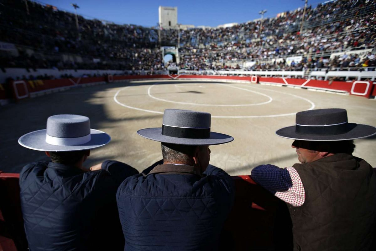 Garcigrande bull breeders attend the Feria de Paques Easter Festivities in Arles, France, on March 26, 2016.