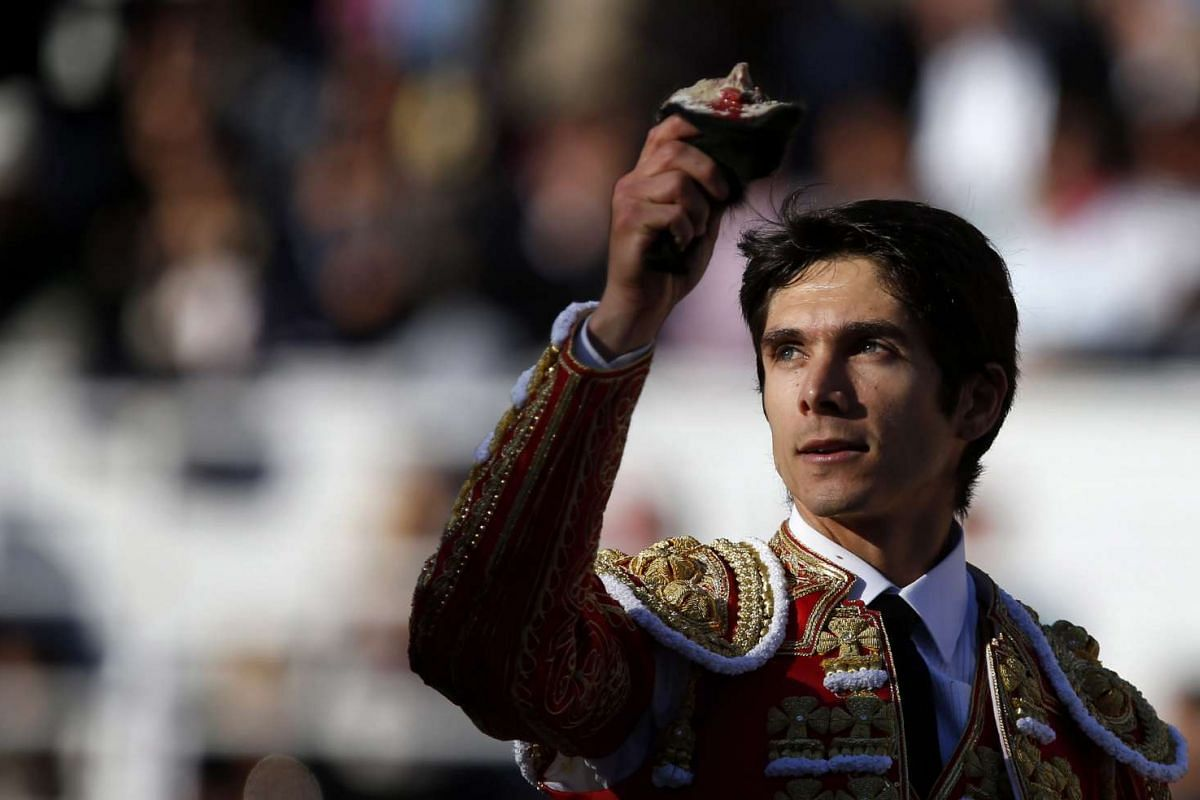 French bullfighter Sebastien Castella holds his trophy after a corrida in Arles, France, 26 March 2016.