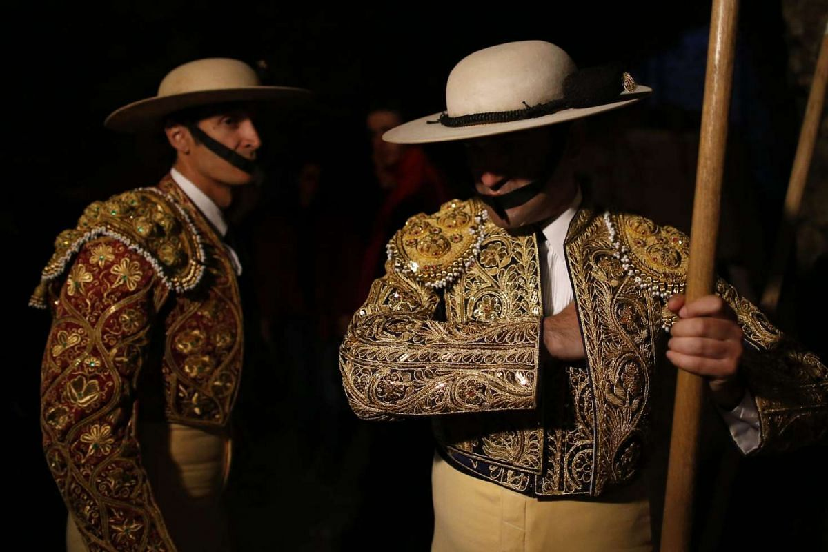 Picadors prepare before a bullfight in Arles, France, on March 26, 2016.