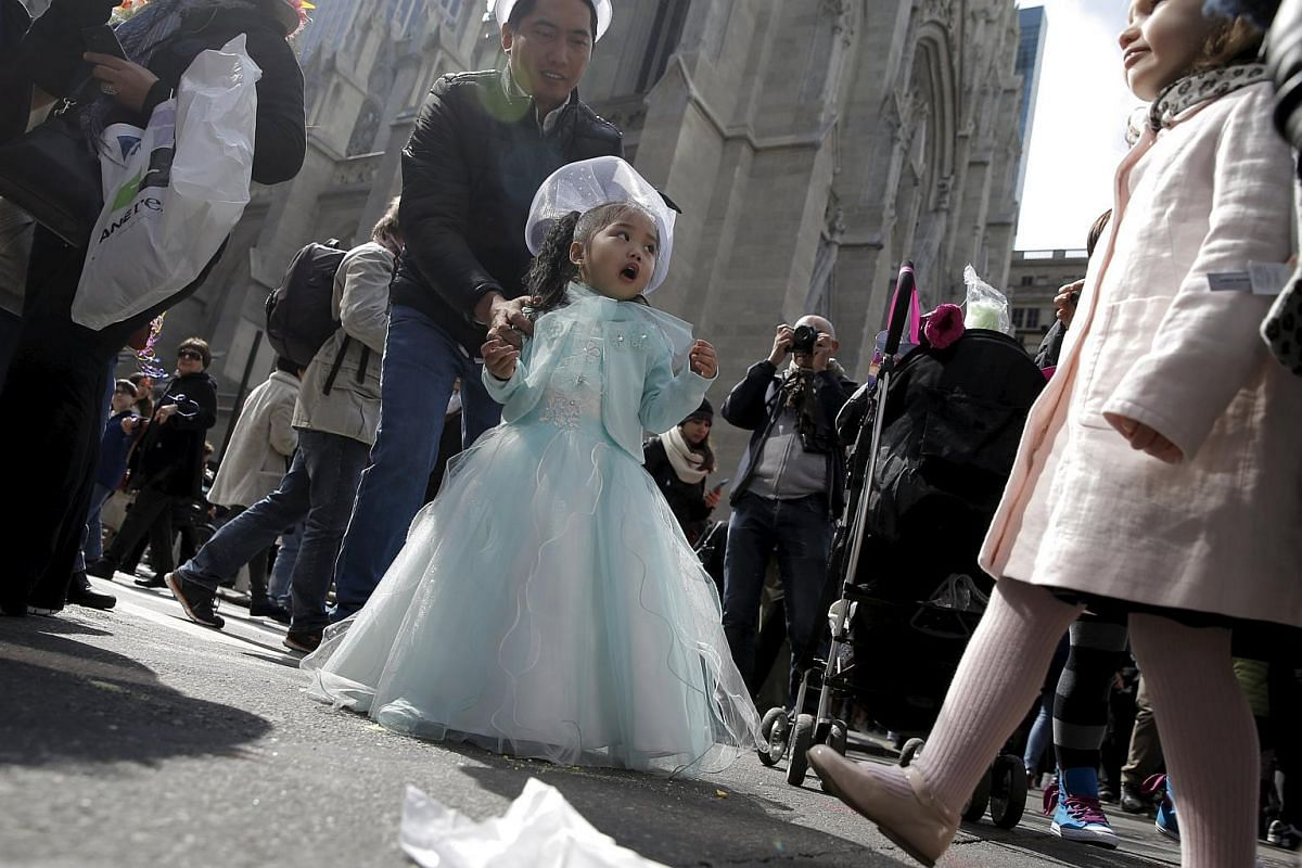 A young girl takes part in the annual Easter Parade and Bonnet Festival along Fifth Avenue in New York City, on March 27, 2016.