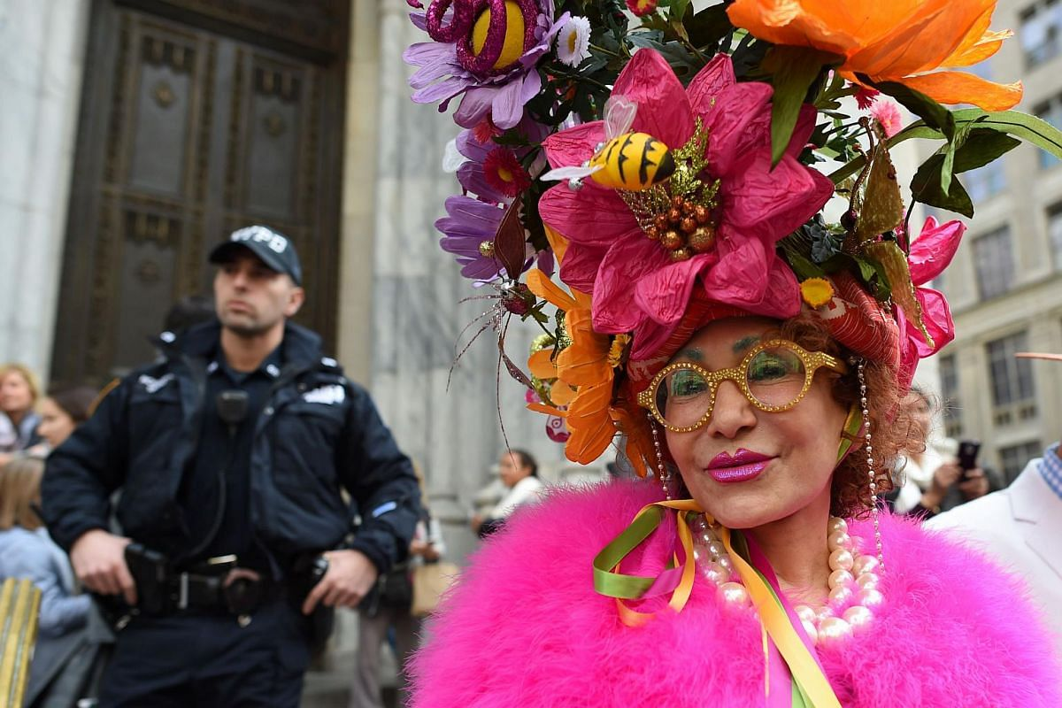 A woman shows off her Easter finery as she walks down Fifth Avenue in New York City, on March 27, 2016.