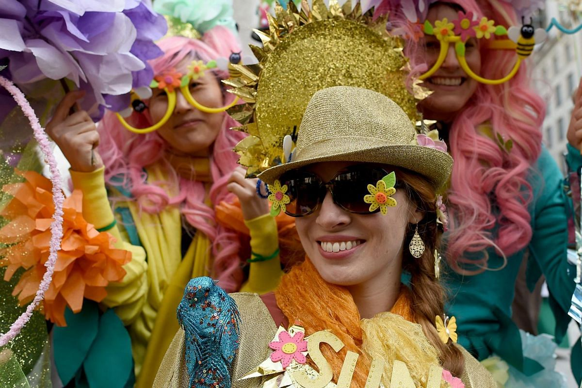 A woman decks out in Easter finery as she parades along Fifth Avenue in New York City, on March 27, 2016.