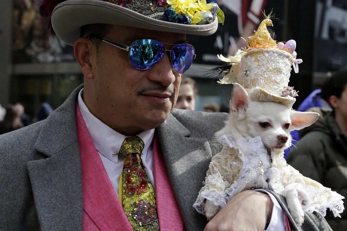 People and dogs attend the Easter Sunday Parade outside St. Patrick's Cathedral on Easter Sunday in New York City, on March 27, 2016.