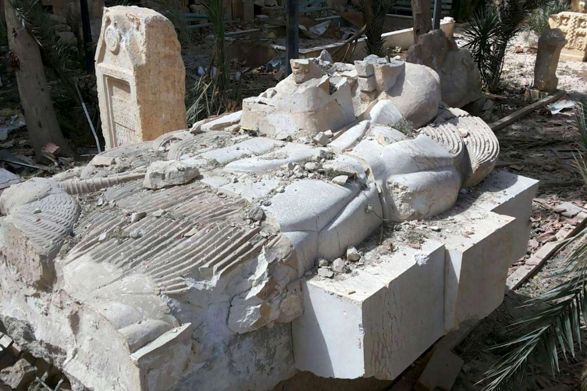 The damaged Lion of Al-Lat statue at the entrance of the Palmyra museum on March 27, 2016.