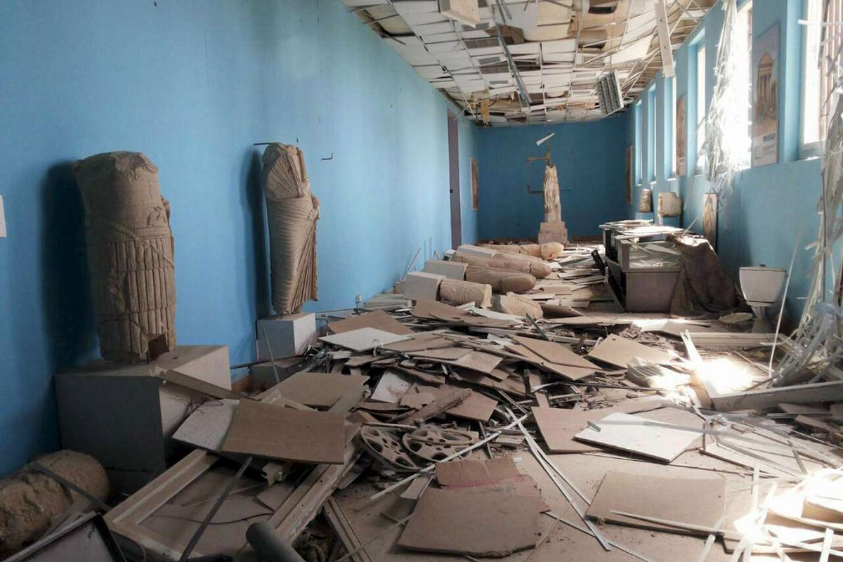 Damaged artefacts inside the museum of the historic city of Palmyra, after Syrian troops recaptured the site from ISIS on March 27, 2016.