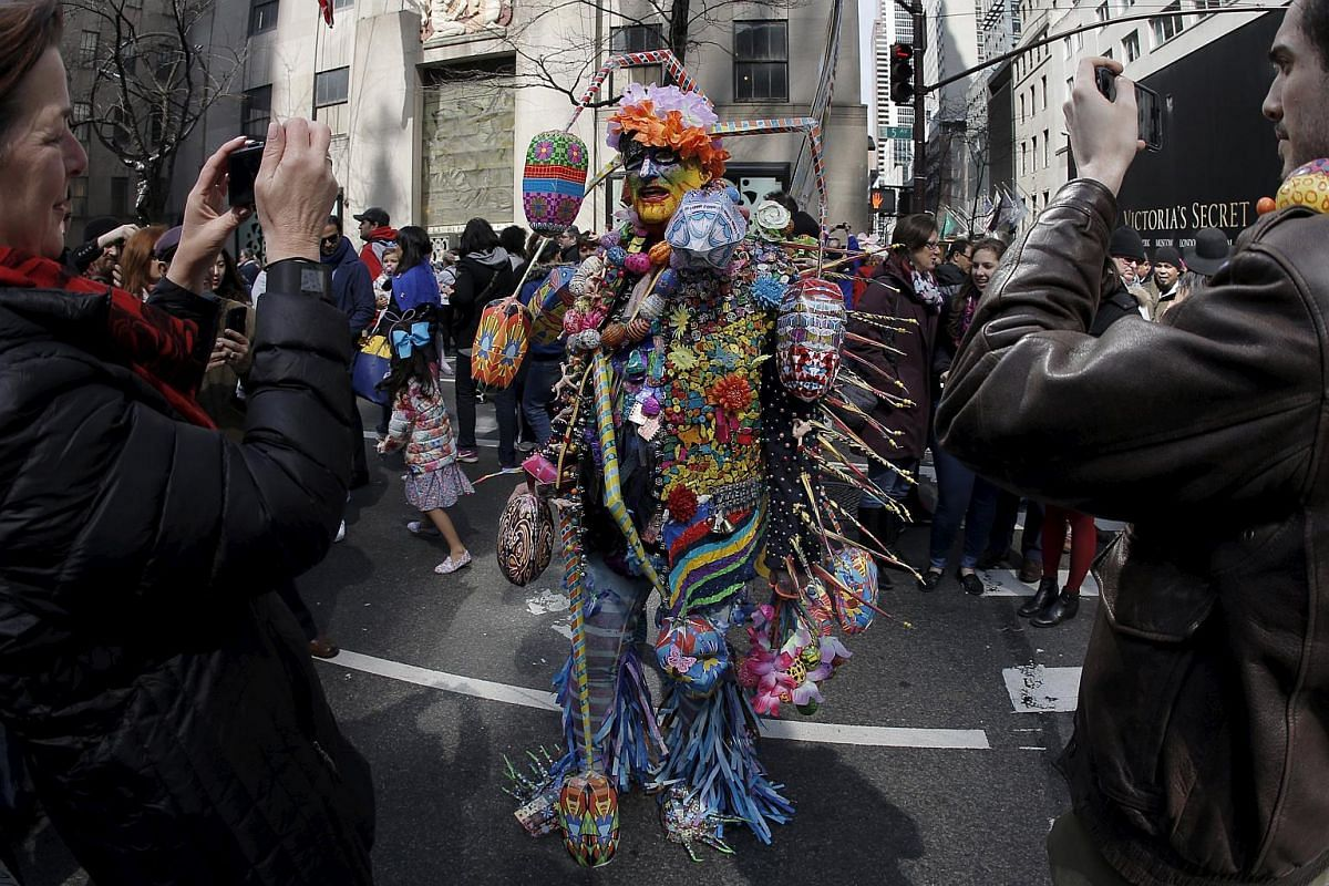 People taking part in the annual Easter Parade and Bonnet Festival along 5th Avenue in New York City on March 27, 2016.