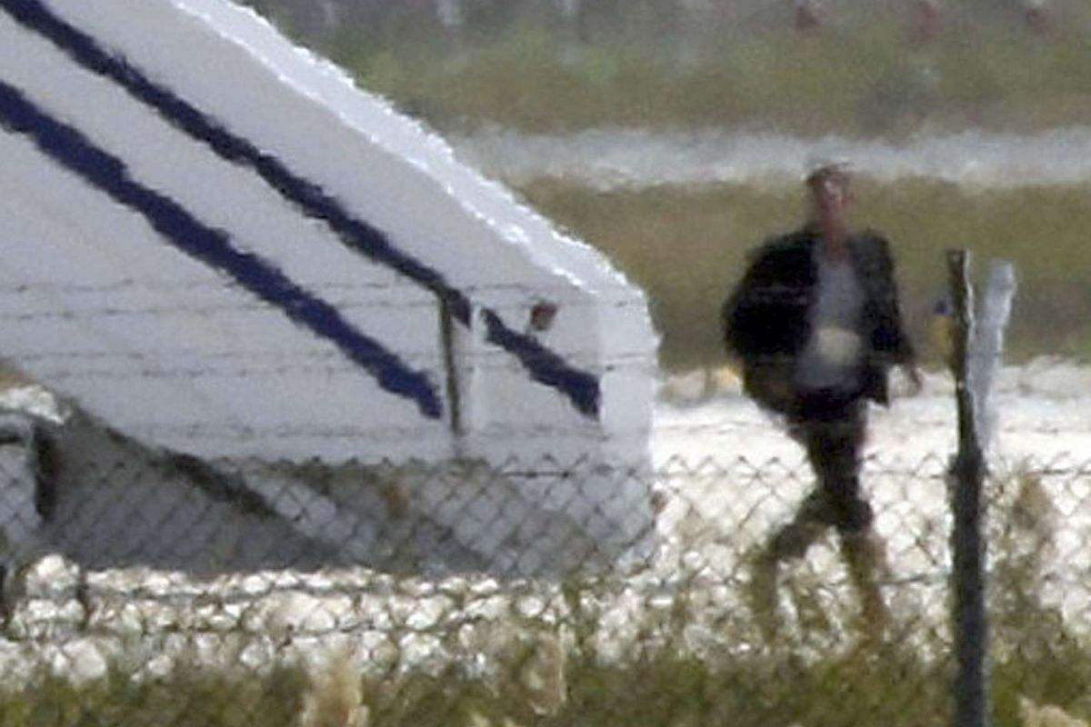 A man believed to be the hijacker of the EgyptAir Airbus A320 leaves the plane before surrendering to security forces on March 29, 2016.