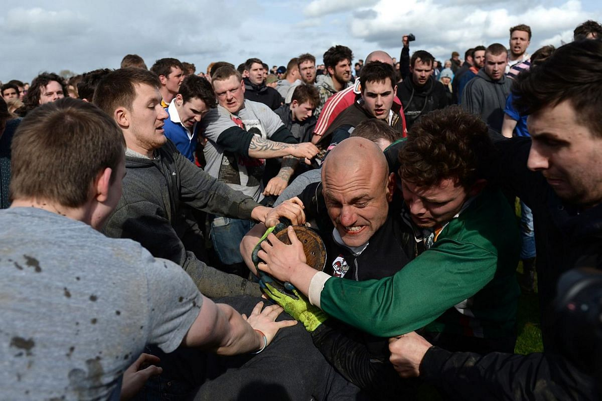 Contestants battle for the bottle in the traditional Easter Monday Bottle Kicking Match, which takes place near the village of Hallaton, on March 28, 2016.