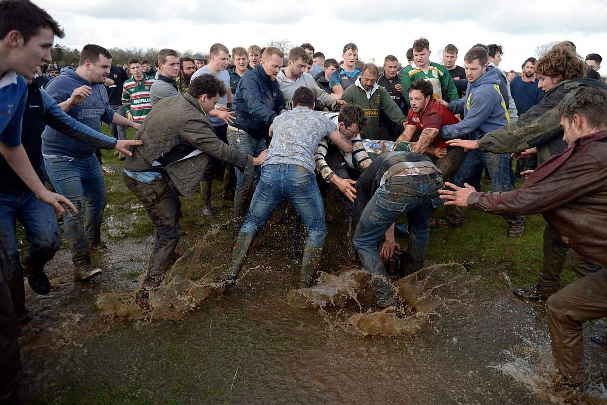 Competitors battle for the bottle in the traditional Easter Monday Bottle Kicking Match, near the village of Hallaton, on March 28, 2016.