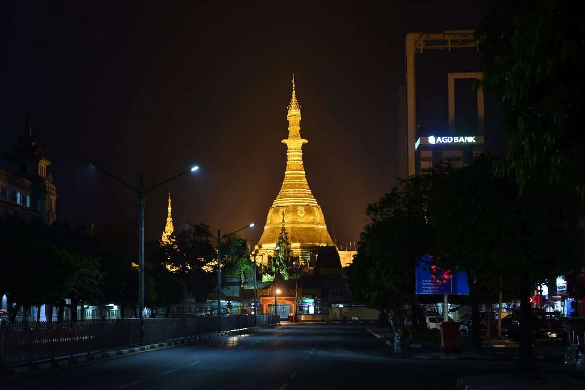 The Sule Pagoda tower, newly covered with gold, glowing under spotlights before dawn on March 23.