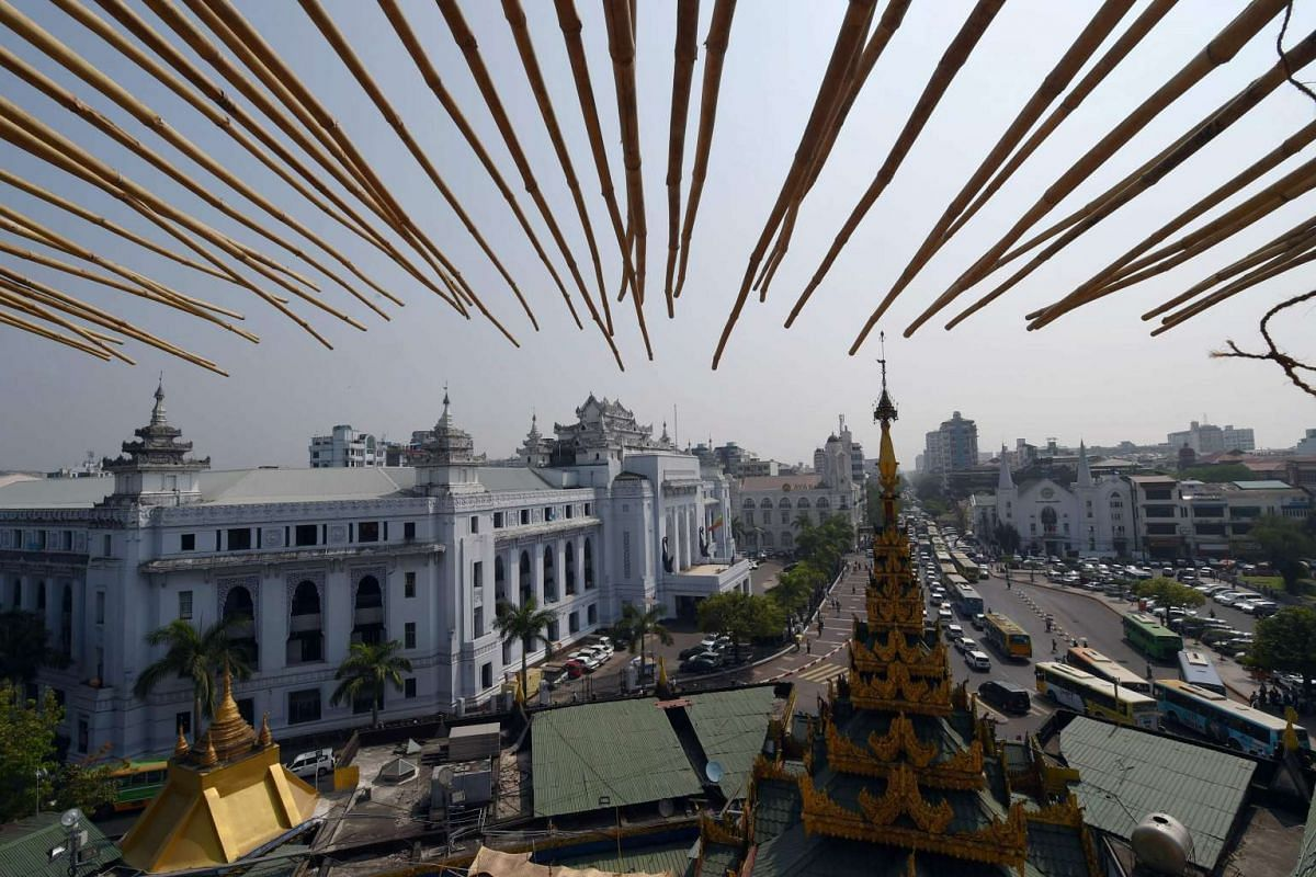 A view from the scaffolding of the Sule Pagoda tower shows the historic Yangon city hall building (left) fronting Mahabandoola road, on March 14.
