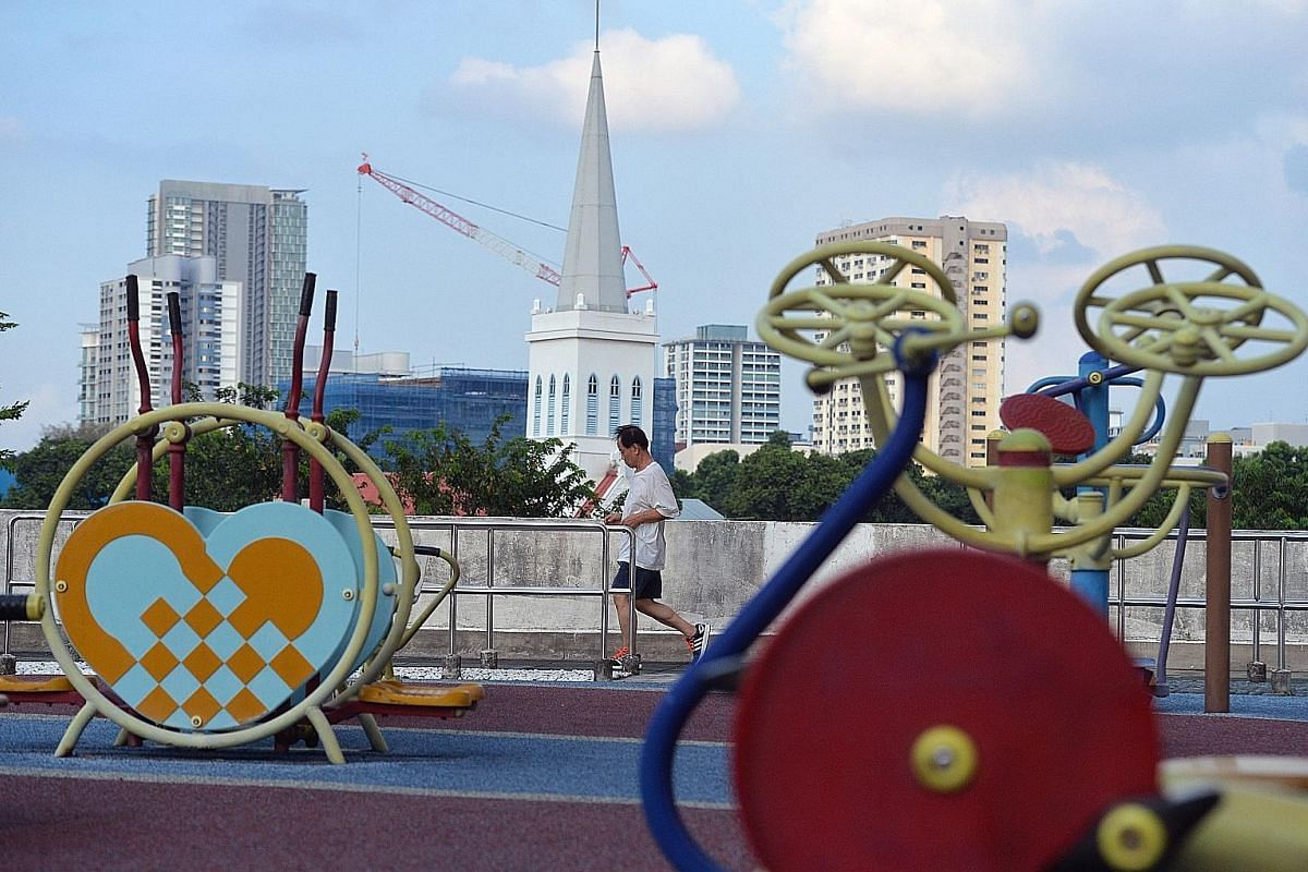 The spacious open-air playground on the fourth floor offers a view of the old and new in Singapore, including the Church of Saints Peter and Paul in Queen Street and a construction crane in the distance. Many of the businesses at Rochor Centre moved