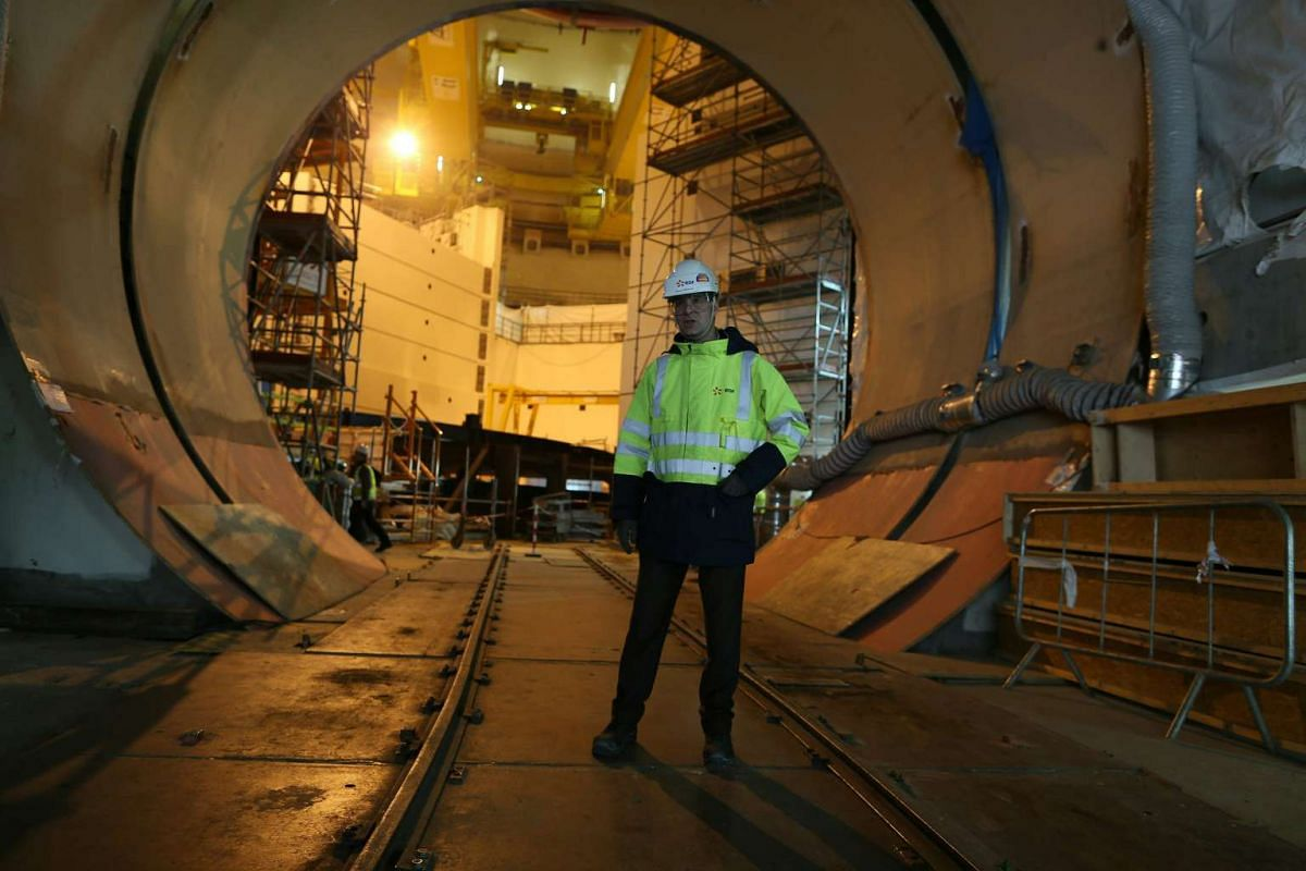 Director of the construction site of the reactor Antoine Menager is pictured inside of the construction site in Flamanville, on March 30, 2016.