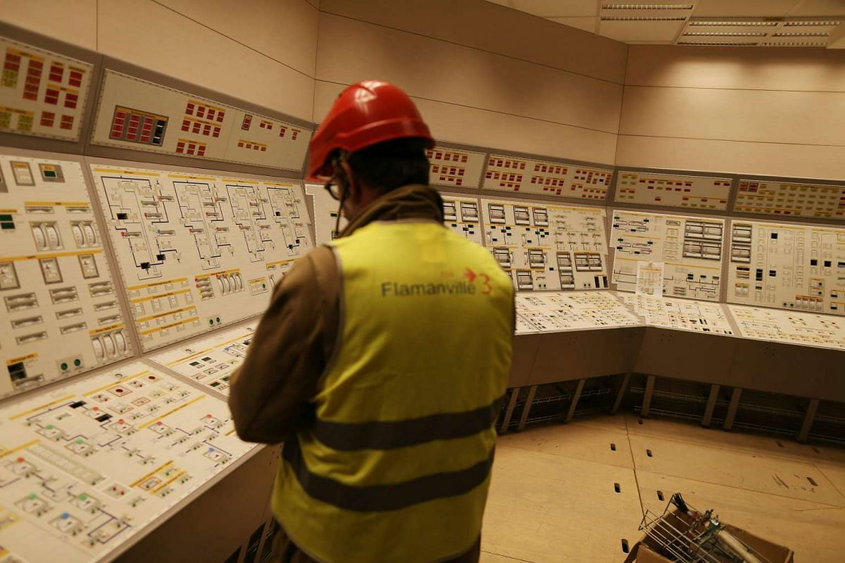 A man is pictured inside of the control room of the construction site of the European Pressurised Reactor project (EPR) in Flamanville, on March 30, 2016.