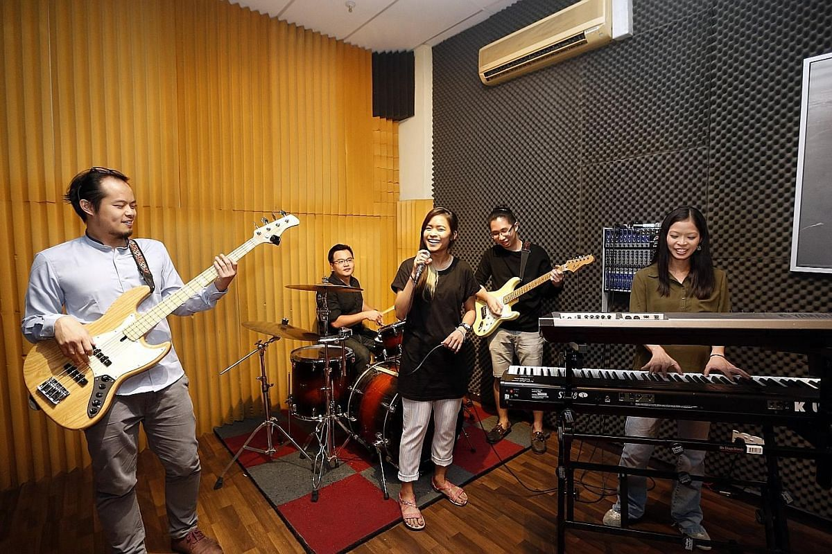 Musicians (from left) Joe Tan, Melvin Liu, Raquel Poh, YC and Olivia Oo jam at Live AMP Studios.