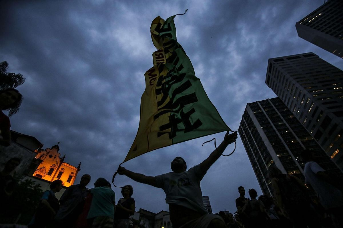 Supporters of the Workers Party participating in a rally in favour of President Dilma Rousseff in down town Rio de janeiro, Brazil, on March 31, 2016.