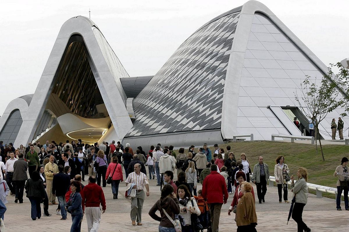 """Bridge Pavilion, Zaragoza (2008): Inspired by gladioli and the waterway beneath it, Hadid's first completed bridge throws 280m of fibreglass reinforced concrete across the river Ebro. The Guardian newspaper called it """"a magnificent and truly ennobl"""