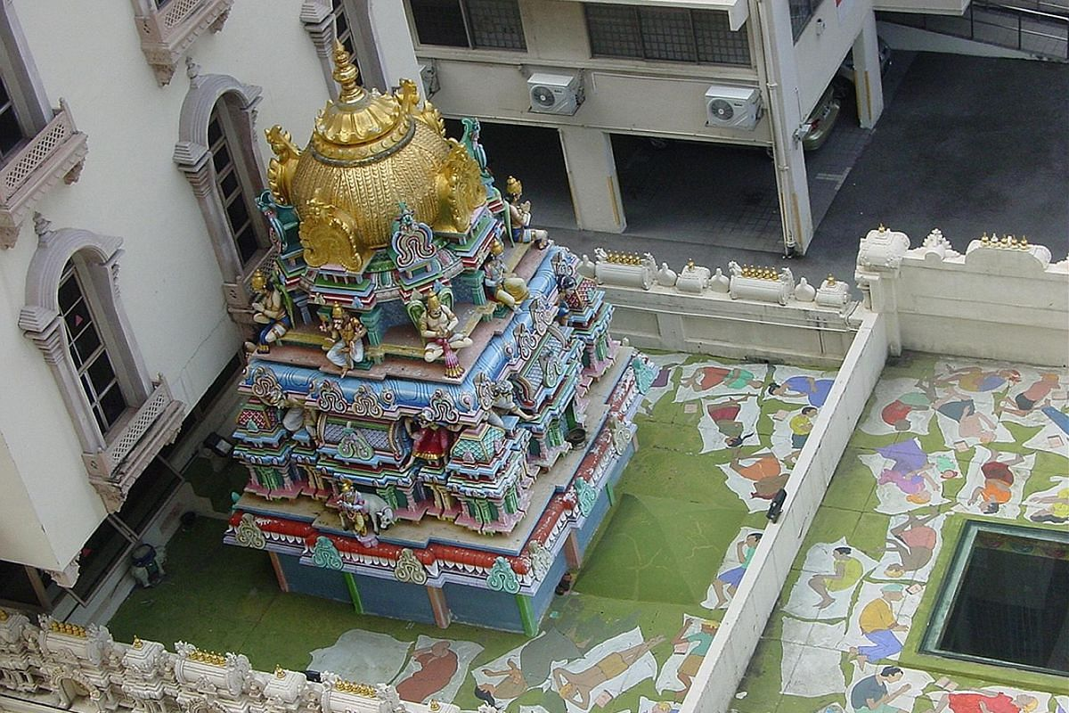 Vividly painted statues (above) adorn the temple's main entrance. The ornate gopuram (left), or main entrance tower, has intricate design work on copper and gold plating. The gopuram, main prayer hall and surrounding boundary walls of the Sri Krishna