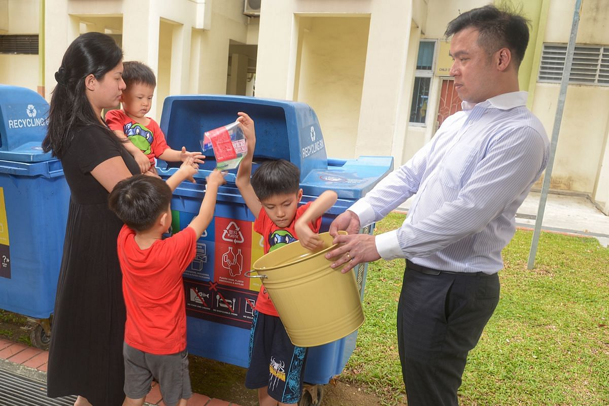 Ms June Lim, Mr James Yeow and their three sons – aged eight, six and three – separate their waste at home.
