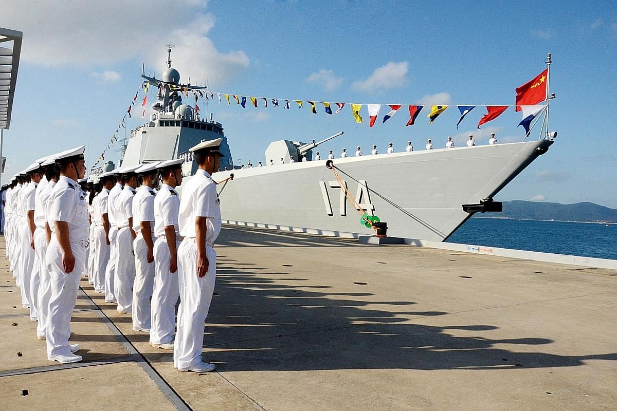 China's navy officers at a ceremony in Sanya, Hainan province, to welcome the Hefei - a guided missile destroyer commissioned by the People's Liberation Army Navy - to the South Sea Fleet in December last year. The province hosts China's conventional