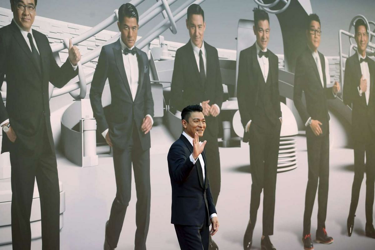 Hong Kong actor Andy Lau poses on the red carpet.
