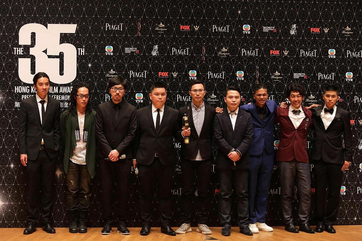 The cast and crew of the controversial film Ten Years pose for a photo after winning Best Film.