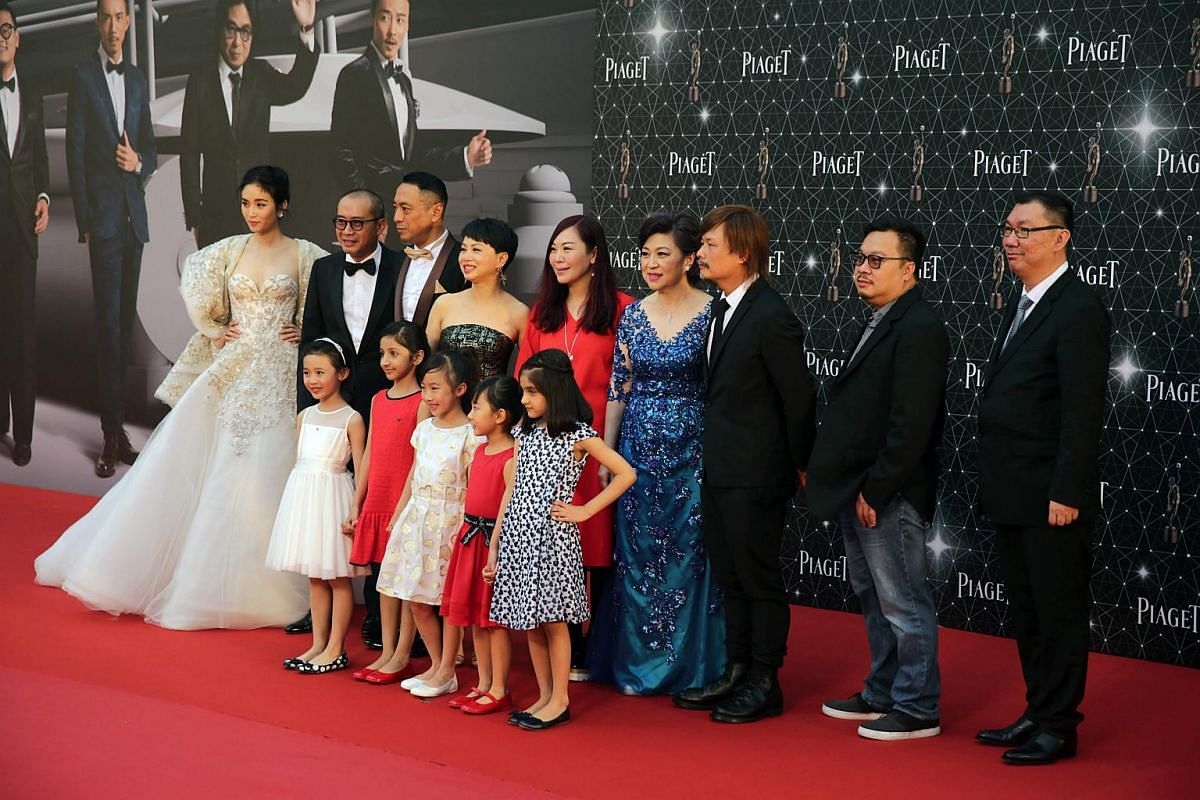 Cast and crew from the drama film Little Big Master pose on the red carpet.