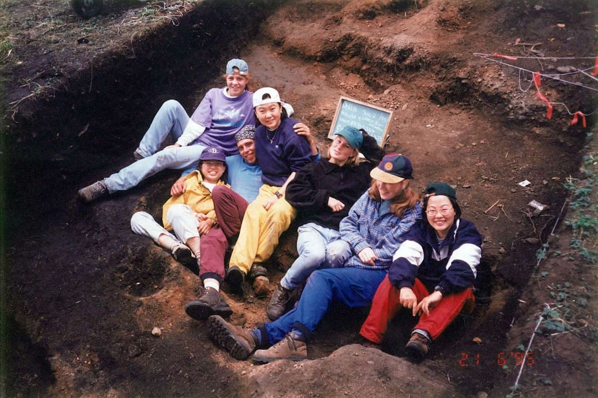 My life so far: Ms Teo (fourth from right, in white cap, blue sweater and yellow trousers) with her schoolmates from the University of British Columbia on an archaeology field trip in British Columbia in 1995.