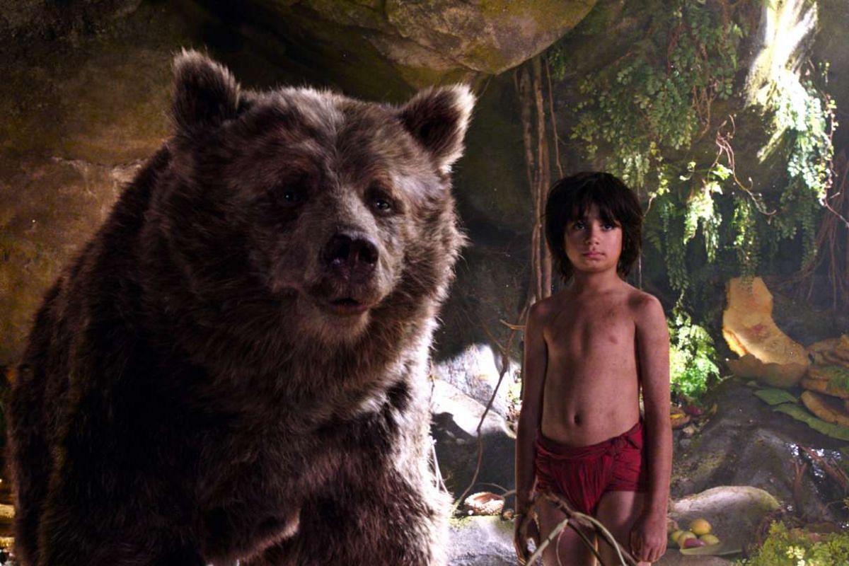 Neel Sethi (right) as Mowgli in The Jungle Book.