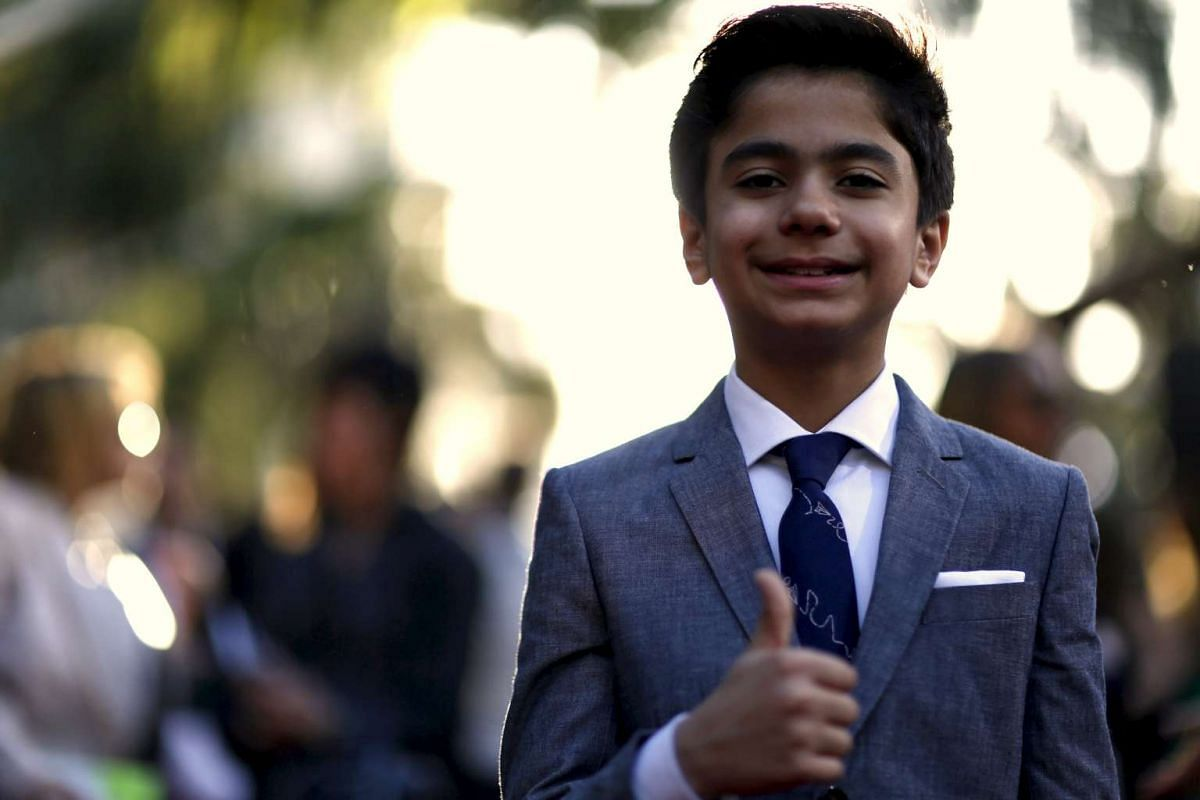 Neel Sethi poses at the premiere of The Jungle Book at the El Capitan theatre in Hollywood, California.