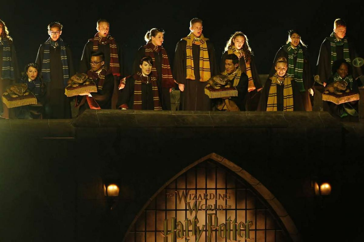 Performers sing at The Wizarding World Of Harry Potter at Universal Studios Hollywood, California on April 5, 2016.