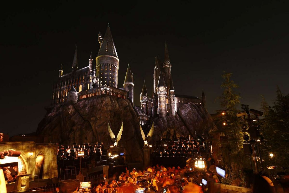Guests wait by a reproduction of Hogwarts Castle at The Wizarding World Of Harry Potter at Universal Studios Hollywood, California on April 5, 2016.