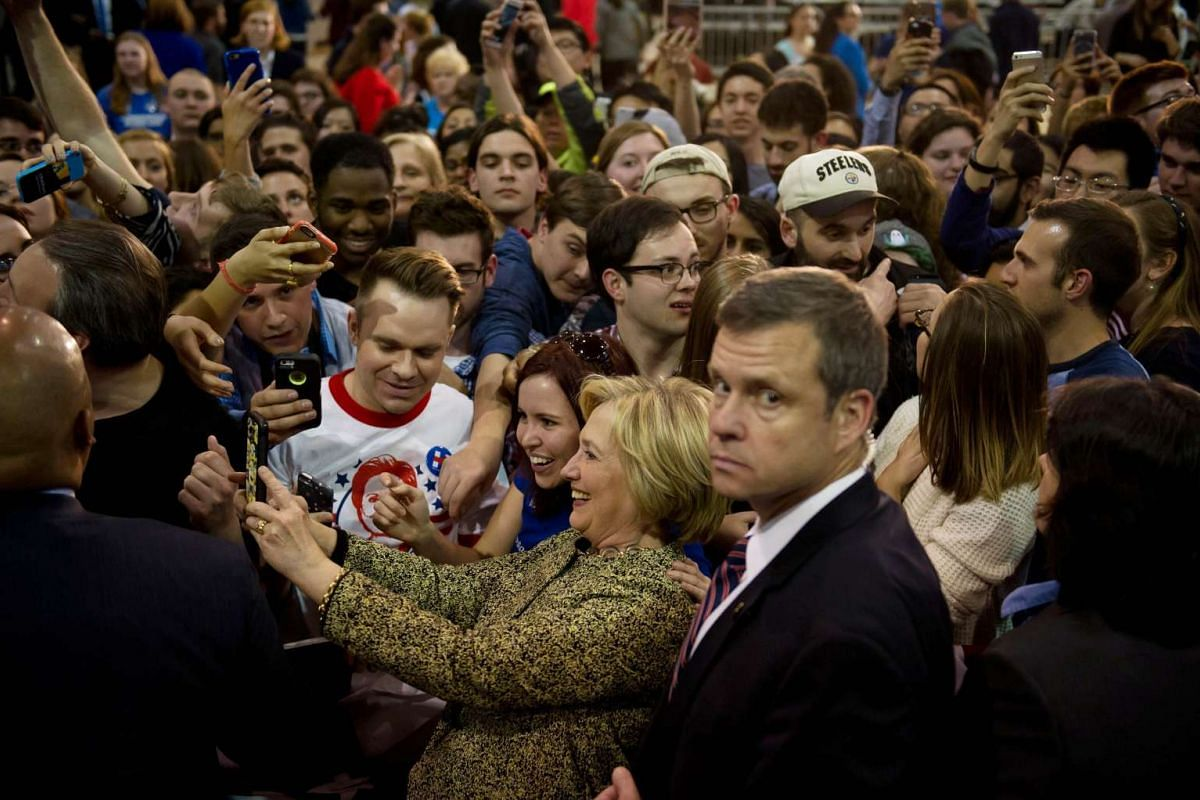 Democratic Presidential candidate former Senator and Secretary of State Hillary Clinton taking a photo with supporters at a rally in Skibo Hall at Carnegie Mellon University on April 6, 2016 in Pittsburgh, Pennsylvania. PHOTO: GETTY IMAGES/AFP