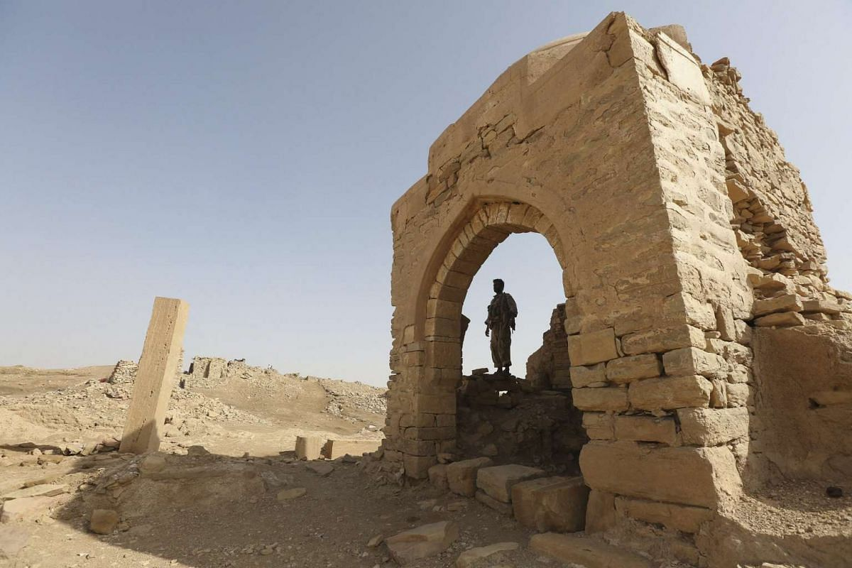 A man stands inside a monument at the historical town of Baraqish in Yemen's al-Jawf province after it was taken over by pro-government forces from Houthi fighters April 6, 2016. PHOTO: REUTERS