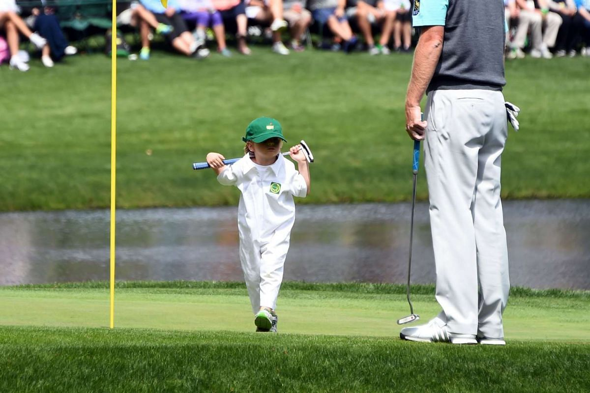 US golfer Brandt Snedeker's son Austin walks to his father on the 9th green during the Par 3 contest prior to the start of the 80th Masters of Tournament at the Augusta National Golf Club on April 6, 2016, in Augusta, Georgia. PHOTO: AFP