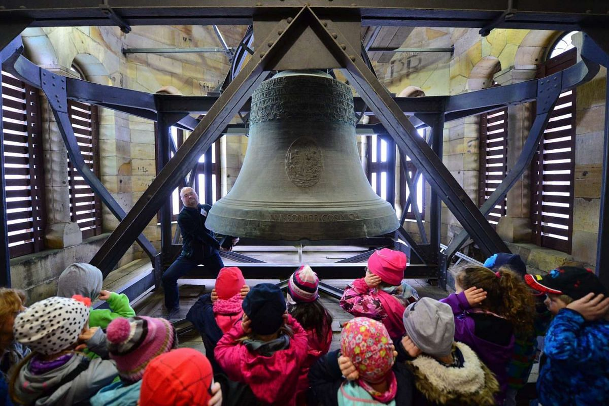 Pre-school children look at the Gloriosa, the trinity bell from 1721 and the world's largest free-swinging mediaeval bell, in the Erfurt Cathedral, in Erfurt, Germany on April 7, 2016.