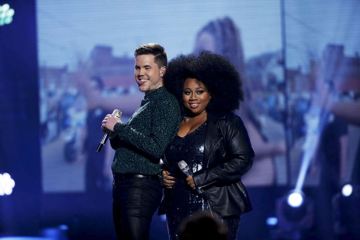 Singers Trent Harmon (left) and La'Porsha Renae perform during the American Idol Grand Finale in Hollywood, California on April 7, 2016.
