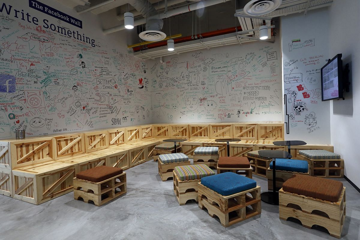 Facebook's famed Wall in an open-concept gathering spot lets staff and visitors scribble and doodle on it.