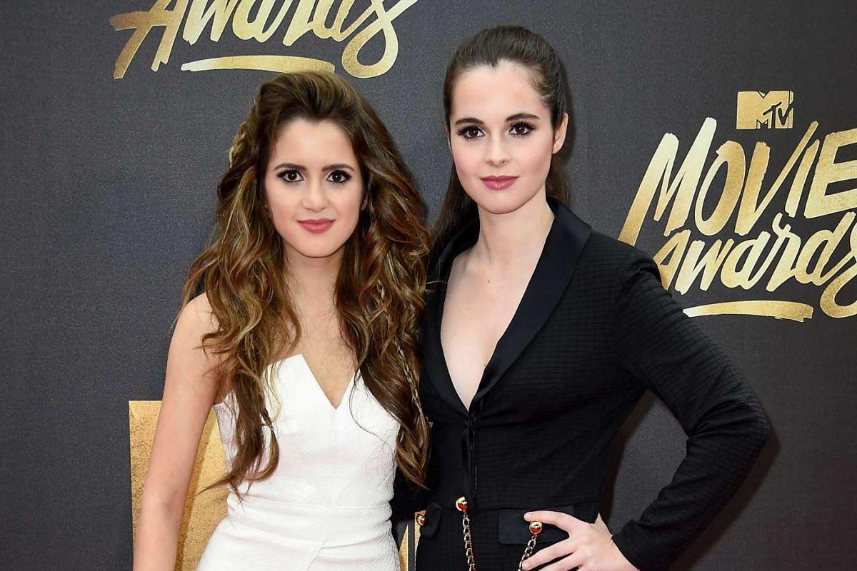 Actresses Laura Marano (left) and Vanessa Marano attend the 2016 MTV Movie Awards in Burbank, California, on April 9, 2016.