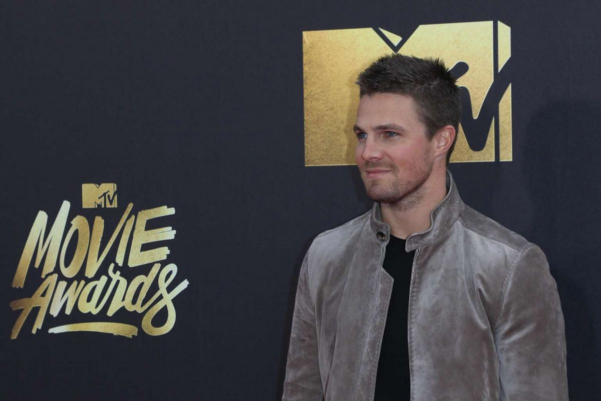 Actor Stephen Amell arrives for the 2016 MTV Movie Awards at the Warner Brothers Studios in Burbank, California, on April 9, 2016.