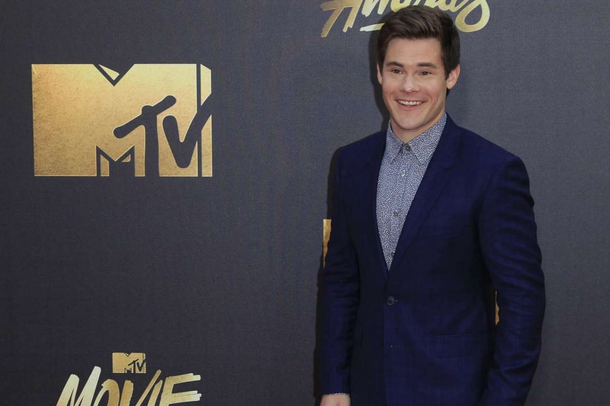 Actor Adam DeVine arrives for the 2016 MTV Movie Awards at the Warner Brothers Studios in Burbank, California, on April 9, 2016.