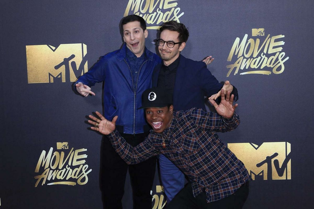 Andy Samberg (left), Jorma Taccone (right) and Jason Mitchell arrive at the 2016 MTV Movie Awards in Burbank, California, on April 9, 2016.