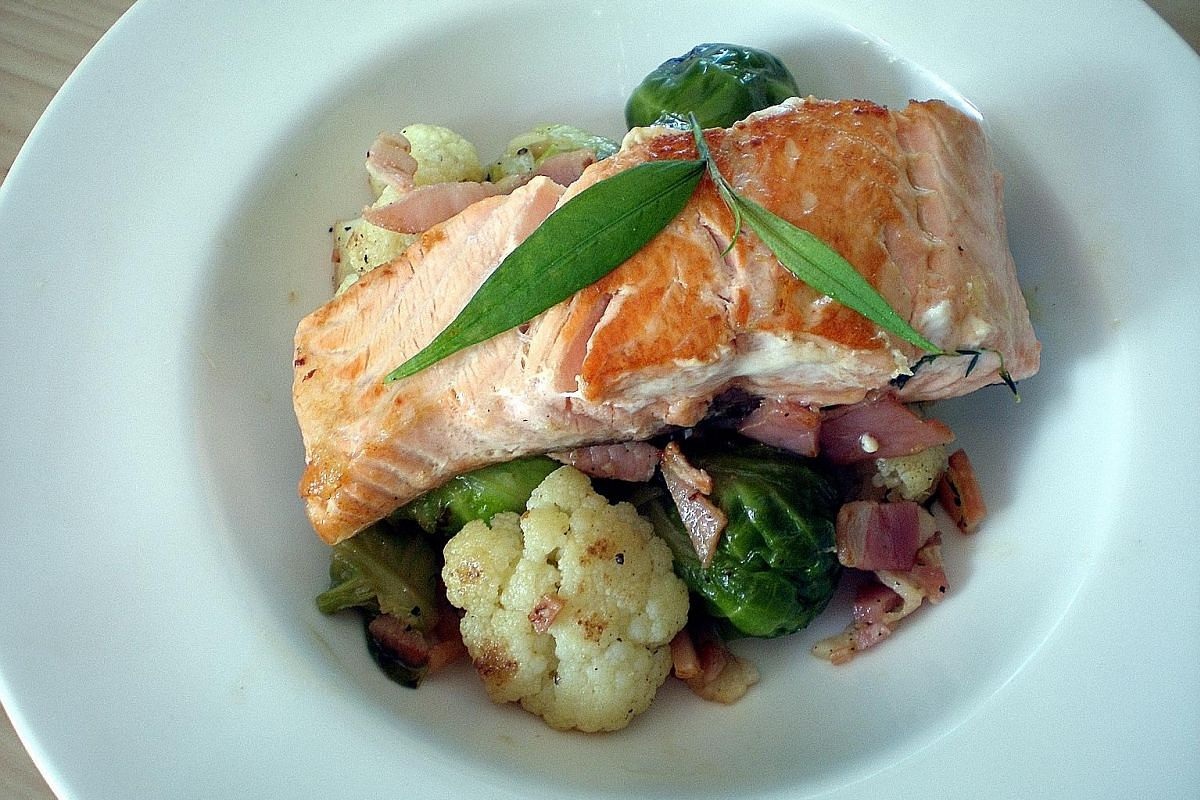 Serve braised Brussels sprouts and cauliflower as a base for a baked or pan-fried salmon fillet.