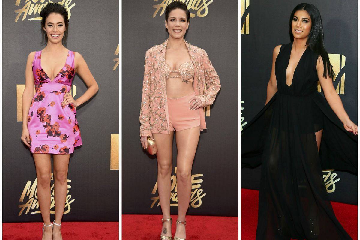 (From left) Actress Chloe Bridges, singer Halsey and actress Chrissie Fit arrive at the 2016 MTV Movie Awards in Burbank, California, on April 9, 2016.