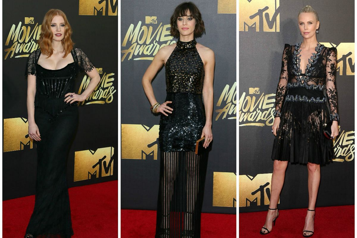 (From left) Actresses Jessica Chastain, Lizzy Caplan and Charlize Theron arrive at the 2016 MTV Movie Awards in Burbank, California, on April 9, 2016.
