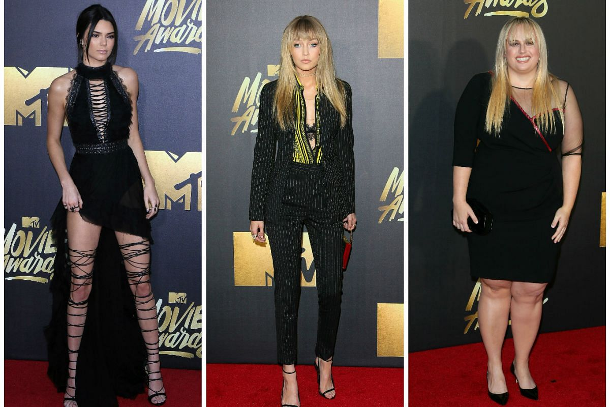 (From left) Models Kendall Jenner, Gigi Hadid and actress Rebel Wilson arrive at the 2016 MTV Movie Awards in Burbank, California, on April 9, 2016.