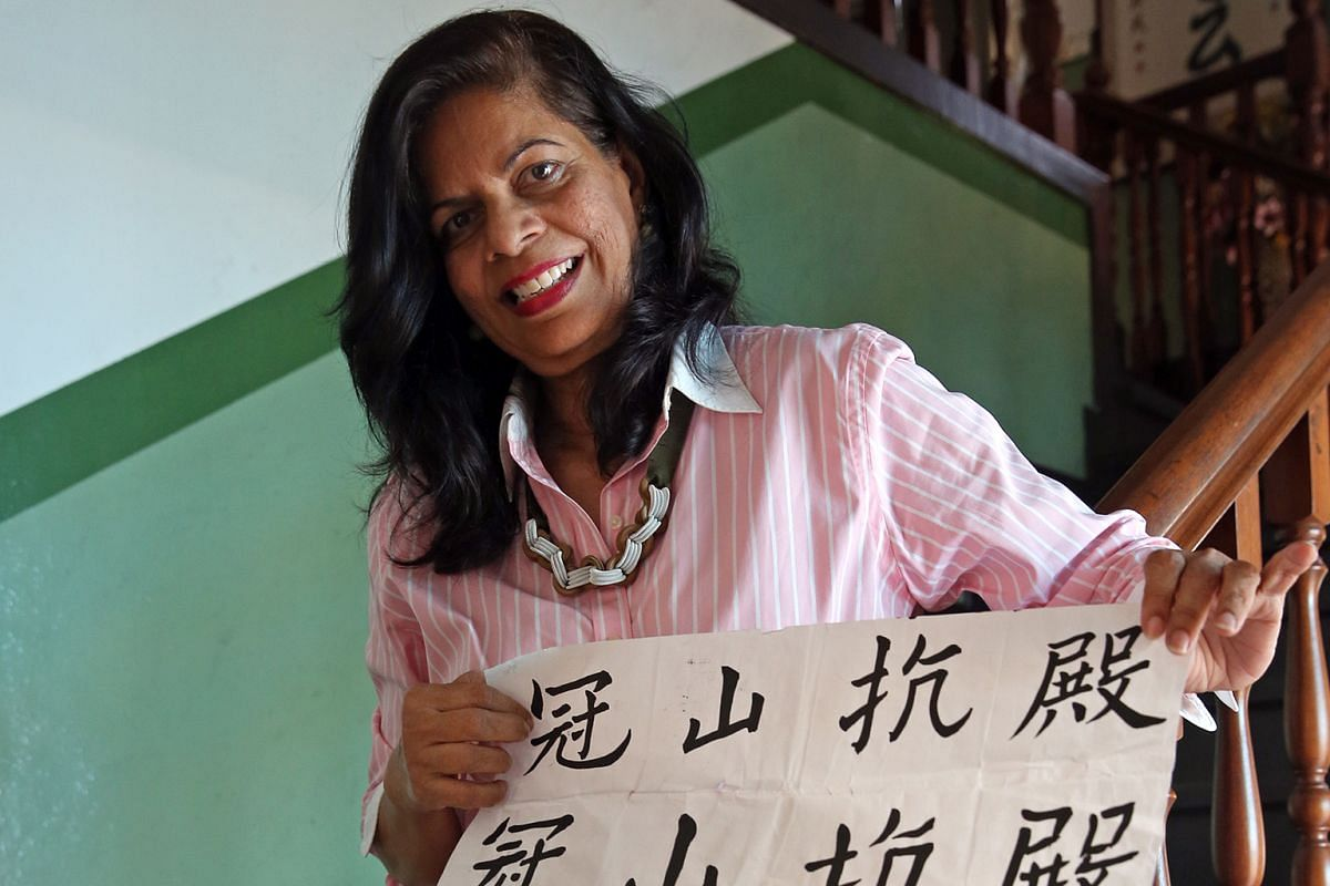 Madam Maria D'Souza has been learning Chinese calligraphy for a year.
