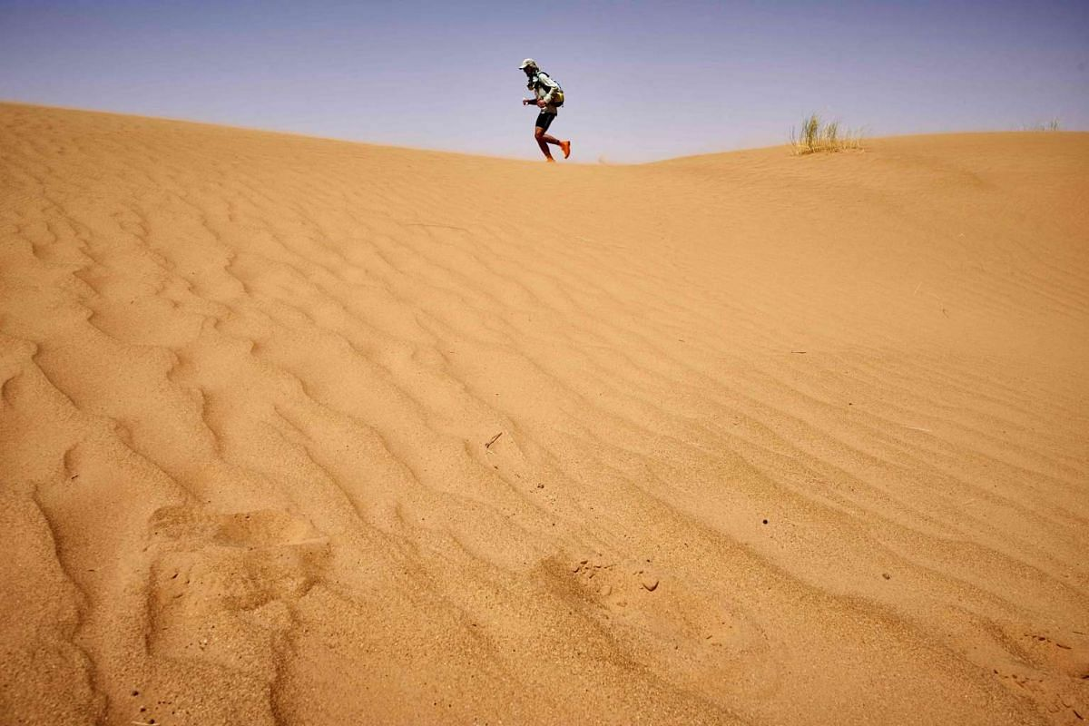 A competitor takes part in the 31st edition of the Marathon des Sables, on April 10, 2016.
